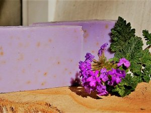 Purple soap near a flower of the same color