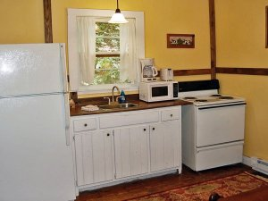 Kitchen with sink, microwave, stove, and fridge