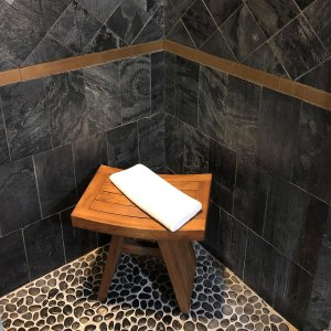 Stool in corner with towelette