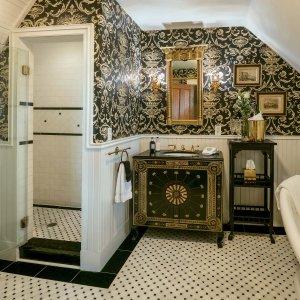Sink, mirror, shelf, and shower in bathroom