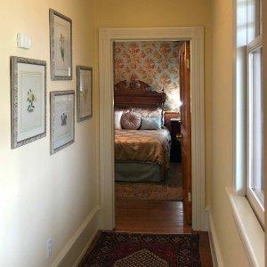 Hallway with doorway to bedroom