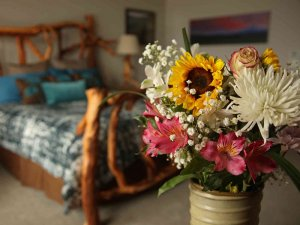 Boquet of flowers in front of bed