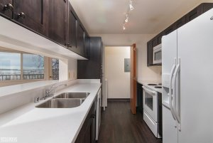 dark wood kitchen cabinets and serving window