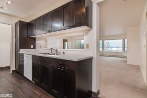kitchen counters and sink with serving window