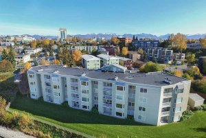 aerial view of four-story apartment complex