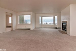 large empty living space with fireplace