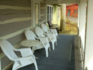 Seats and table lined up on porch