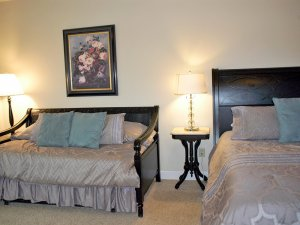 Trundle bed between two lamps