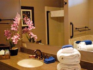 Flower arrangement next to sink and mirror in bathroom