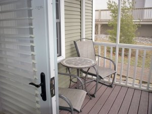 Chairs and a table on a porch