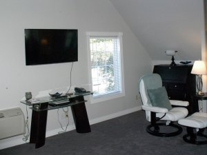 Television above tabletop in living room