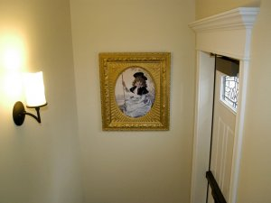Picture frame at end of stairway by door