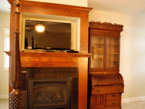 Fireplace, television, and cabinet