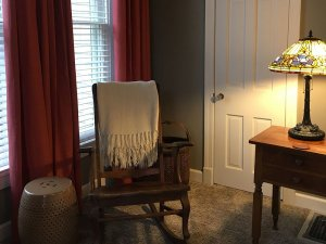 Rocking chair next to lamp in living room