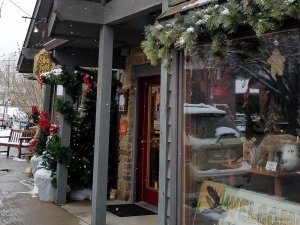 Front entrance of snowy shop