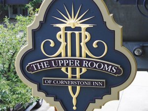 Close up of upper rooms sign