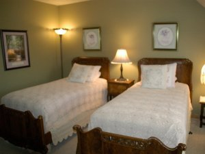 Two twin-sized beds side by side in room