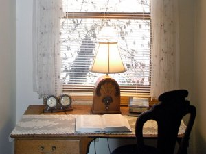 Book and radio at desk by window