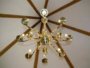 Chandelier hanging from center of towered ceiling