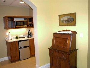 Wood cabinet next to doorway of kitchen