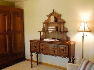 Large vanity next to wardrobe and lamp
