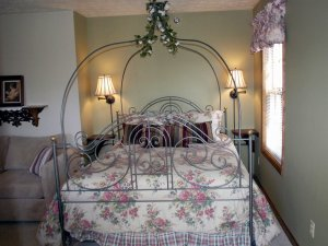 Wire-frame bed next to window