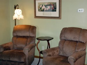 Reclining chairs next to a lamp and table