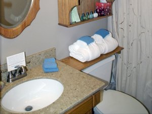 Sink, toilet, and towels in bathroom