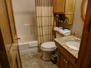 Shower next to toilet and sink