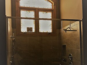 Glass shower with tinted window above it