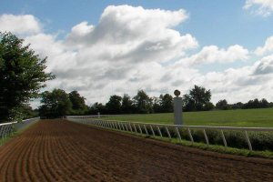 dirt horse track and cloudy sky