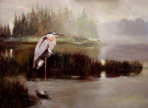 great blue heron watching sunrise