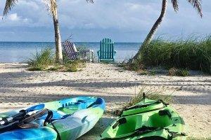 Kayaks laying on the sand