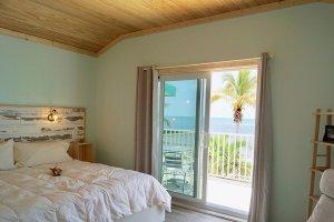 bed near a sliding glass door