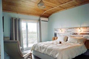 Bedroom with glass doors to balcony
