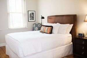 Bed with wood headboard in bedroom
