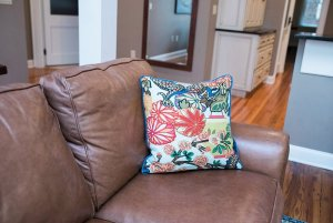 Decorative pillow on leather couch