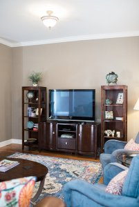 Television on entertainment center in living room