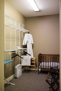 Hangers in bedroom with crib
