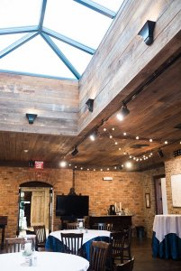 Skylight above wood-paneled ceiling