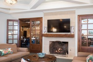 Fireplace next to glass doors to dining room