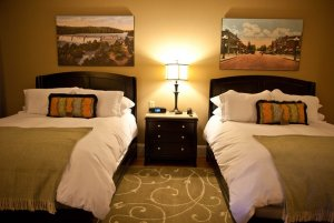 Queen-sized beds with paintings above