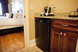 Mini-fridge and coffee maker in kitchenette