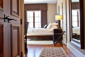 Closet in hallway leading into bedroom