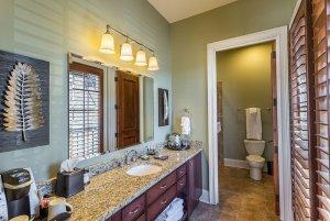 Long bathroom counter next to door to toilet room