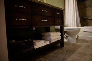 Towels folded under bathroom sink