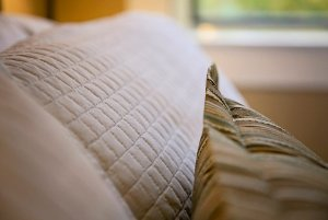 Quilted pillows on bed