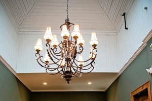 Chandelier hanging from tall ceiling