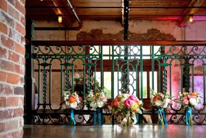 Flower arrangements infront of railing