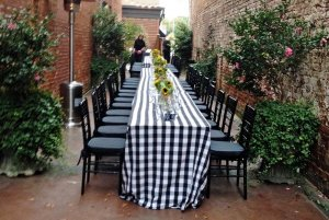 Banquet table in alley with shrubery